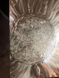 Detail results of multiple grinds to create sphere
